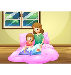 A mother reading with her daughter vector image