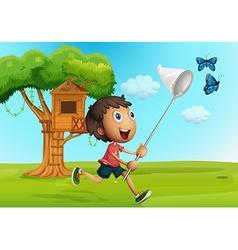 Boy catching butterflies in the garden vector image