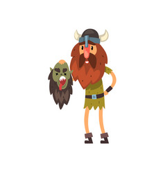 Viking holding head of his dead enemy in his hands vector
