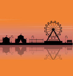 Silhouette of amusement park with reflection vector