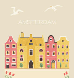 An amsterdam street with traditional old buildings vector