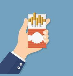 hand holding cigarette pack flat design vector image