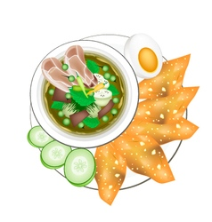 Thai Green Curry with Boiled Egg and Fried Wonton vector
