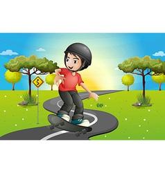 A boy skateboarding at the road vector image vector image