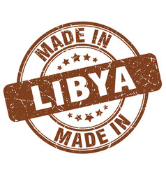 Made in libya brown grunge round stamp vector