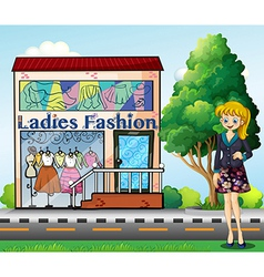 A lady in front of the ladies fashion store vector