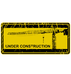 Under construction stamp with crane silhouette vector