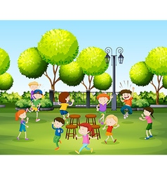 Children playing music chair in the park vector image