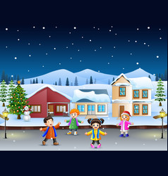 happy kids playing in front of the snowing village vector image