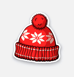 red winter hat with pompon and snowflake pattern vector image