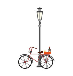 Vintage bike with wine and cheese on streetlight vector