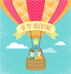 Boy and girl in love in a hot air balloon vector image