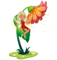 A fairy floating near the giant flower vector image