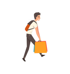 Young man carrying heavy shopping bags guy vector