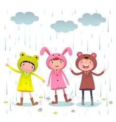 Kids wearing colorful raincoats and boots playing vector image