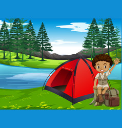 a boy camping in forest vector image