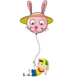 A playful young boy holding a balloon vector image