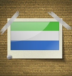 Flags SIERRA lEONEat frame on a brick background vector image