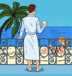 Man drinking coffee at the balcony pop art vector