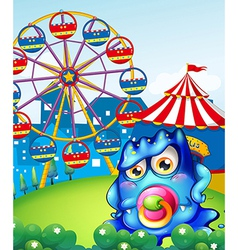 A baby blue monster at the carnival vector