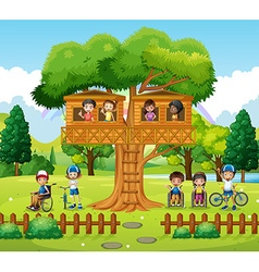 Children playing at the treehouse in the park vector image vector image