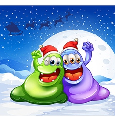 A green and a violet monster wearing a red hat for vector