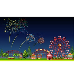 Amusement park scene at night with fireworks vector