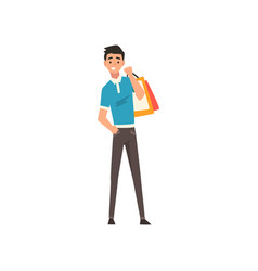 Smiling young man with shopping bags guy vector