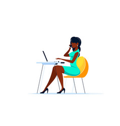 Young black woman working on computer in office vector