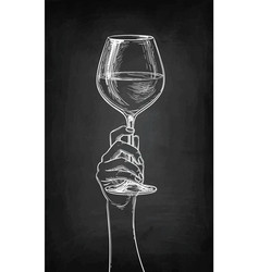 hand holding a glass of wine vector image