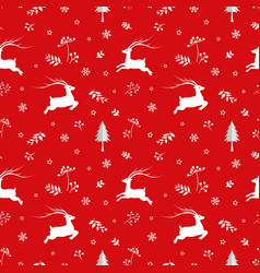 seamless pattern with deers and snowflakes on red vector image