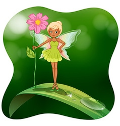 Fairy holding pink flower on the leaf vector