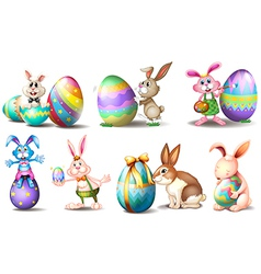 Easter eggs with playful bunnies vector image