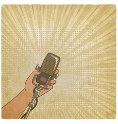 Female hand with retro microphone vector