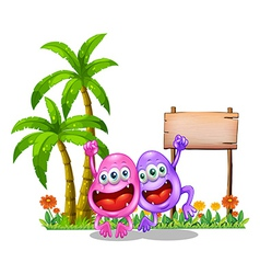 Two happy monsters near the empty wooden signboard vector image