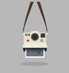 Hanging retro instant camera vector