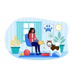 Girl feeding her dog vector