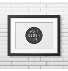 realistic black frame a4 on brick wall vector image