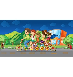 Family riding on bicycle at night vector