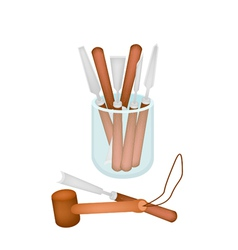 Set carving tools in a jar vector