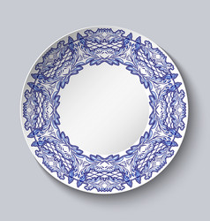 plate decorated with blue floral patterns in the vector image