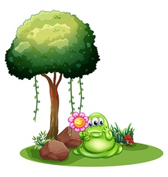 A monster holding a flower standing near the tree vector