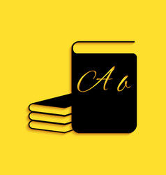 Black abc book icon isolated on yellow background vector