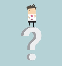 Businessman standing on question mark vector image