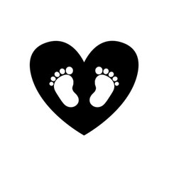 baby footprints inside of black heart icon vector image vector image