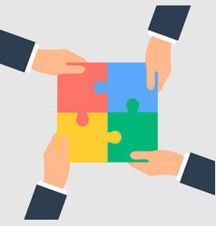 business hands putting puzzle pieces together vector image