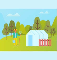 Farmer with fork near greenhouse with red fence vector