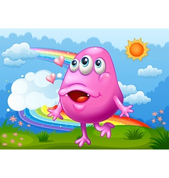 A happy pink monster dancing at the hilltop with a vector image
