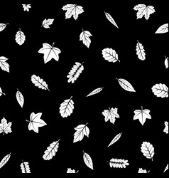 seamless texture of leaves on a black background vector image