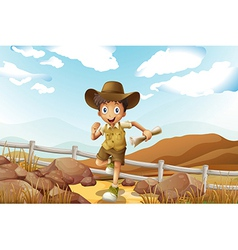 A young explorer running with a map in his hand vector